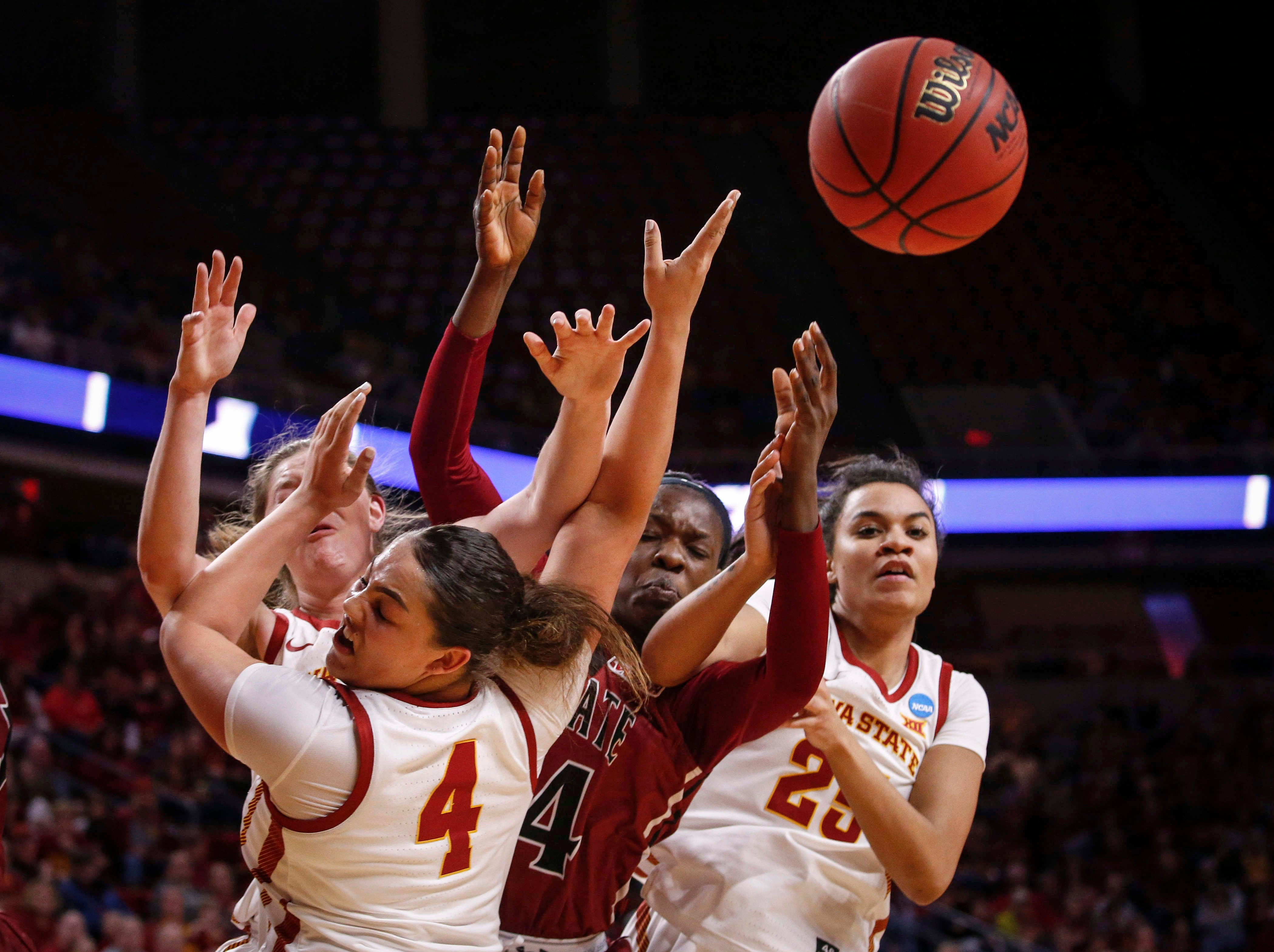 Members of the Iowa State basketball team battle New Mexico State's Adenike Aderinto for the loose ball in the fourth quarter on Saturday, March 23, 2019, at Hilton Coliseum in Ames.