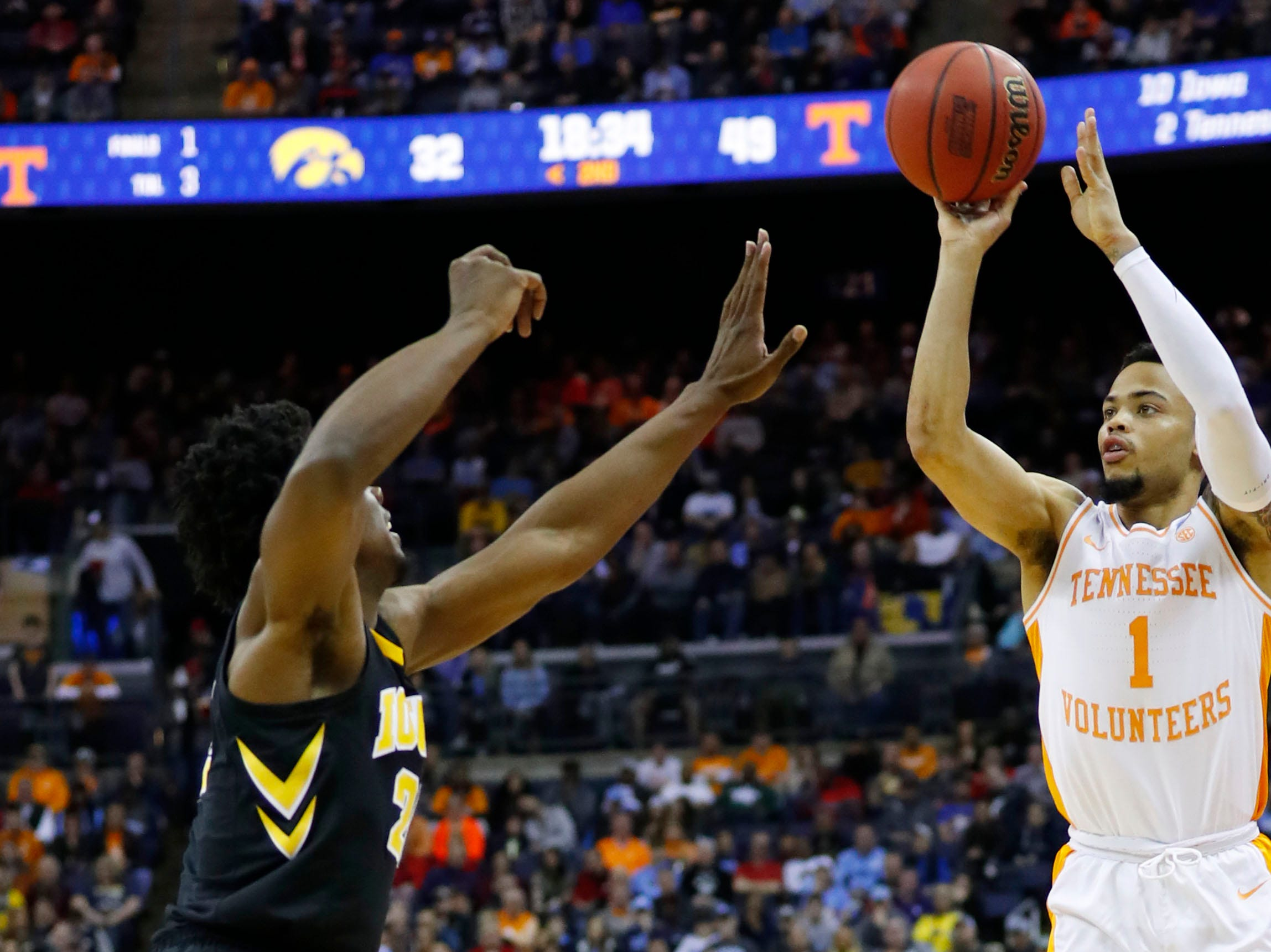 Tennessee Volunteers guard Lamonte Turner (1) shoots the ball over Iowa Hawkeyes forward Tyler Cook (25) in the second half in the second round of the 2019 NCAA Tournament at Nationwide Arena.