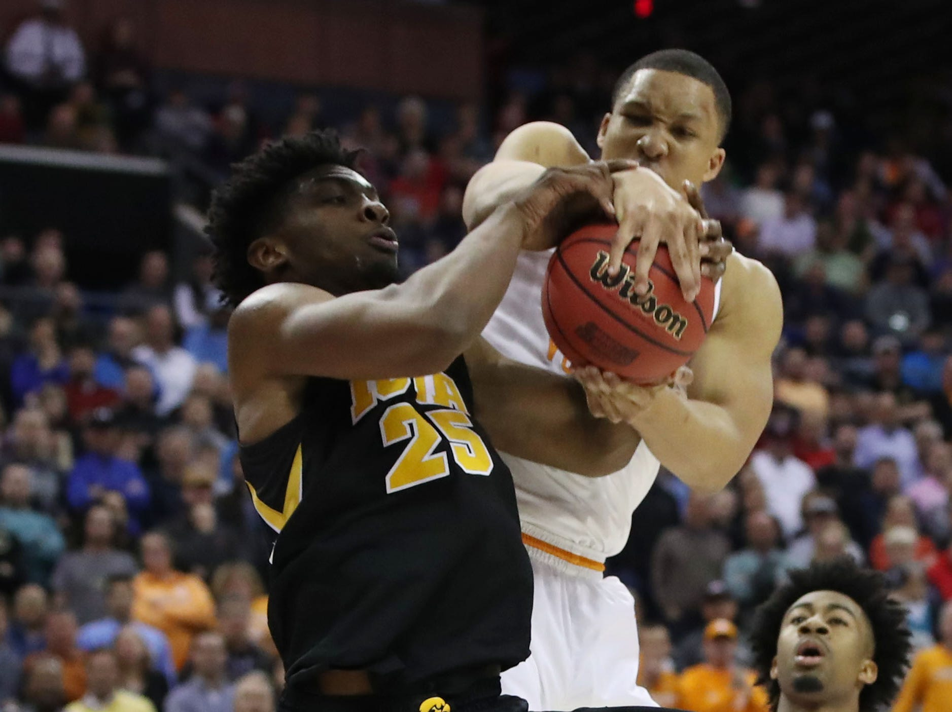 Tennessee Volunteers forward Grant Williams (2) steals the ball from Iowa Hawkeyes forward Tyler Cook (25) in the second half in the second round of the 2019 NCAA Tournament at Nationwide Arena.