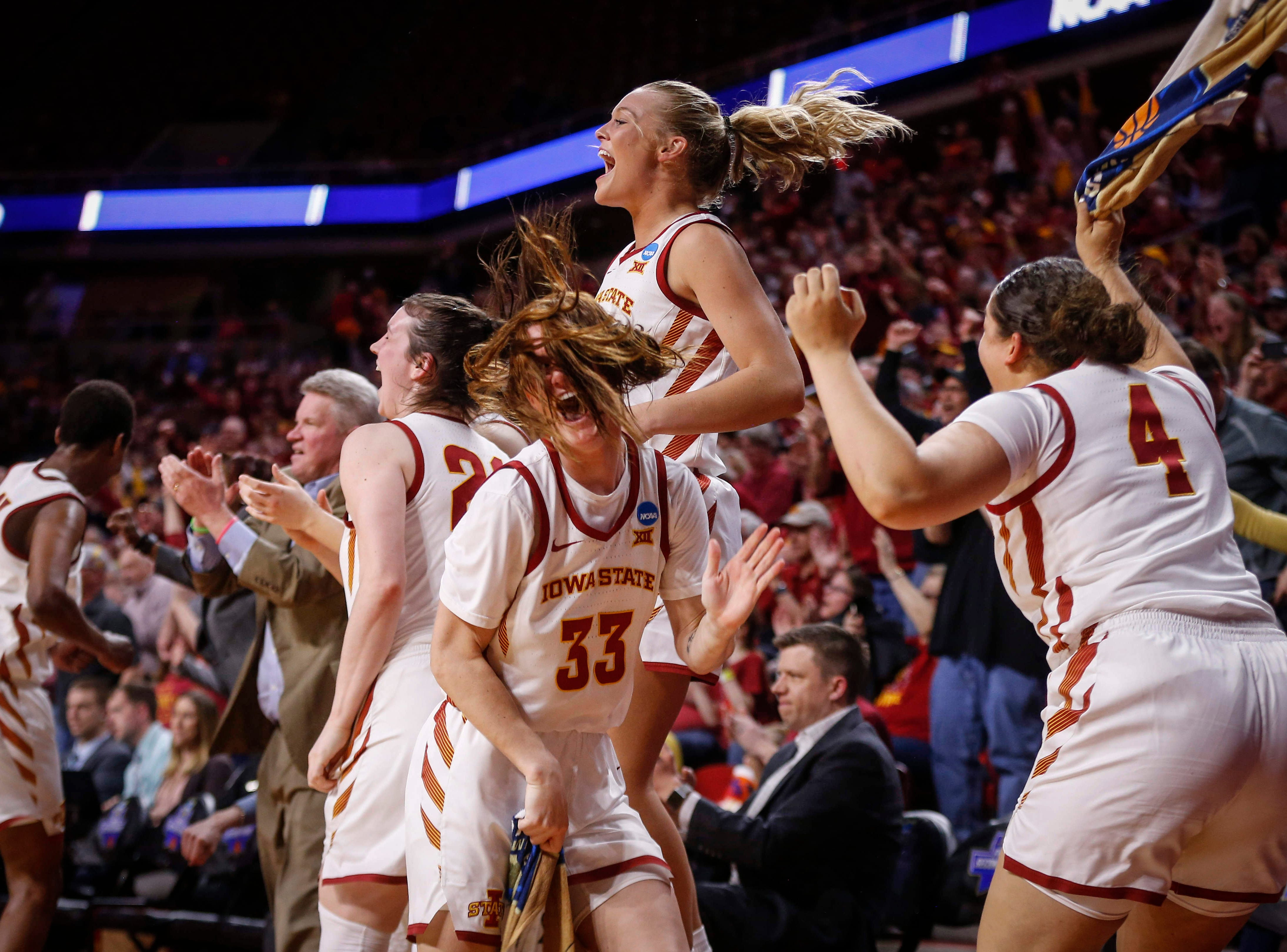Members of the Iowa State women's basketball team celebrate a NCAA first round win against New Mexico State on Saturday, March 23, 2019, at Hilton Coliseum in Ames.