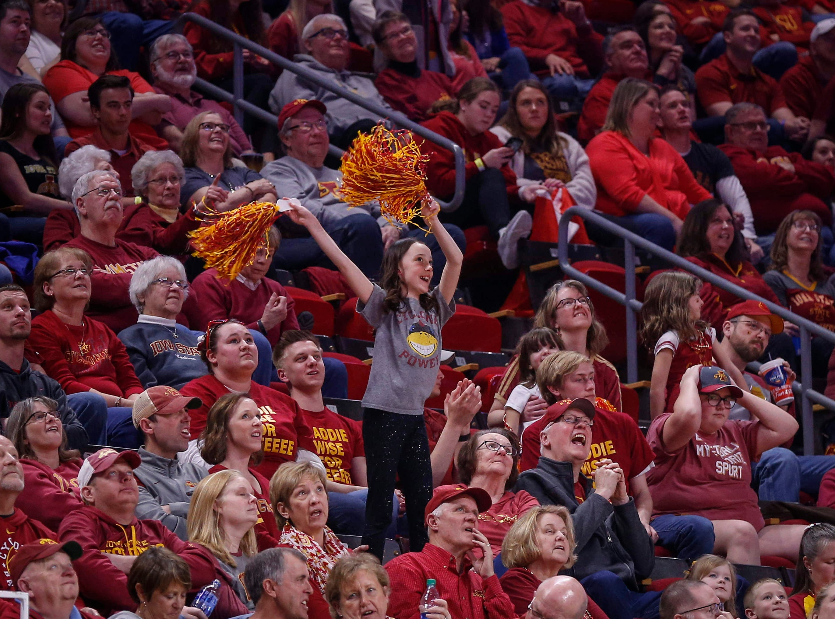 A young Iowa State fan cheers on the Cyclones women's basketball team as they cruise to a win over New Mexico State on Saturday, March 23, 2019, at Hilton Coliseum in Ames.