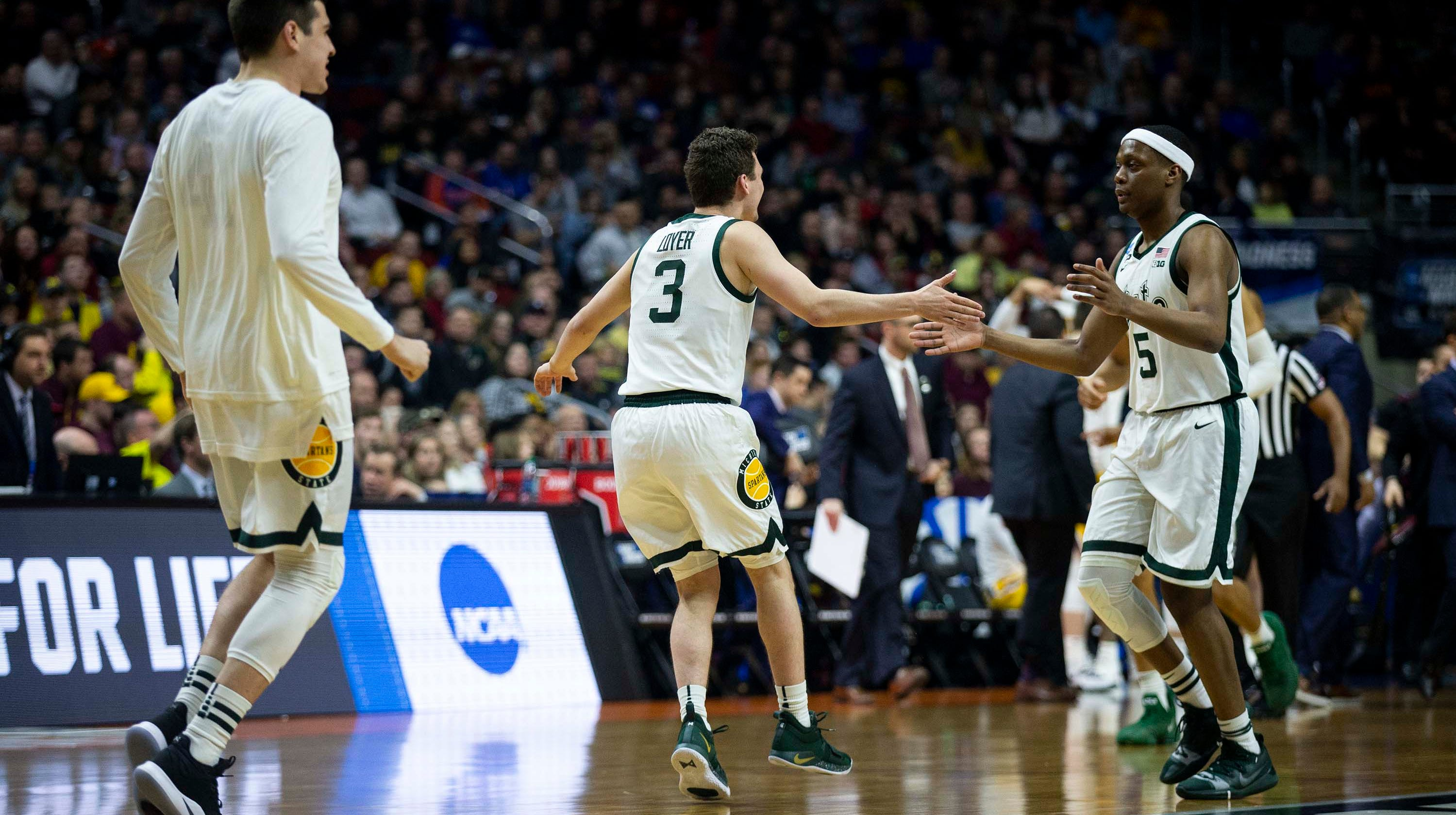 NCAA in Des Moines: Michigan defense drowns Gators; Michigan State clobbers Gophers