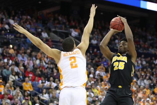 Iowa Hawkeyes forward Tyler Cook (25) shoots the ball over Tennessee Volunteers forward Grant Williams (2) in the second half in the second round of the 2019 NCAA Tournament at Nationwide Arena.