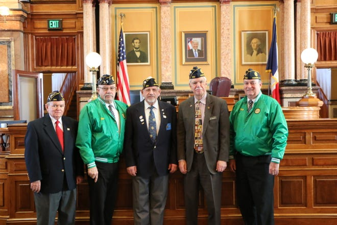 American Legion members Chuck Fenimore from Winterset Post 184,  and Dean C. Yordi, Stan Merrell, state Rep. Stan Gustafson and Doug Pierce, all from Cumming Post 562 celebrate the Legion's 100th anniversary at the state Capitol.