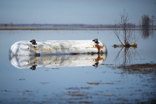 A tank near Sidney is half-obscured with floodwater on Friday, March 22, 2019.