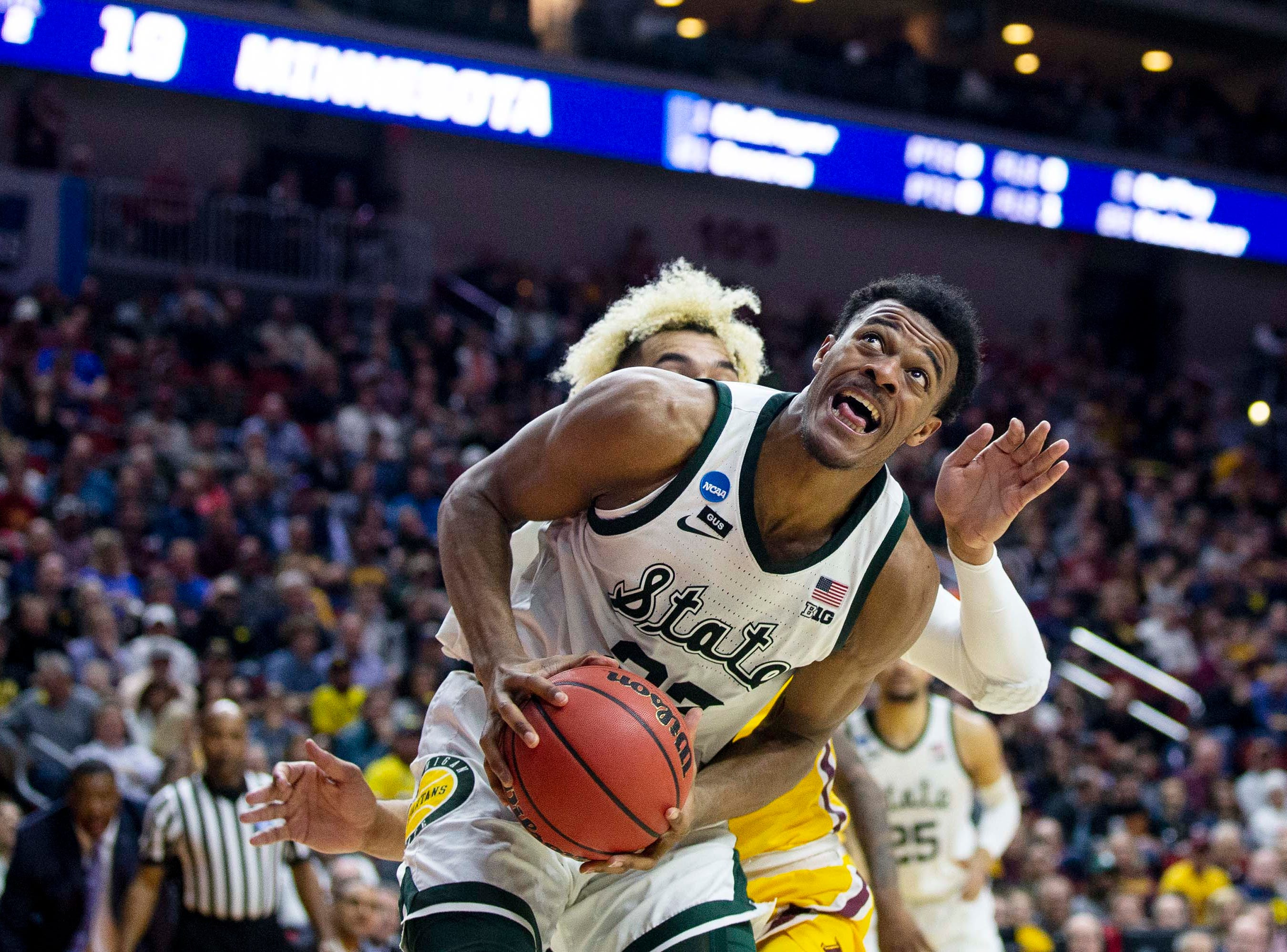 Michigan State's Xavier Tillman looks to make a shot during the NCAA Tournament second-round match-up between Minnesota and Michigan State on Saturday, March 23, 2019, in Wells Fargo Arena in Des Moines, Iowa.