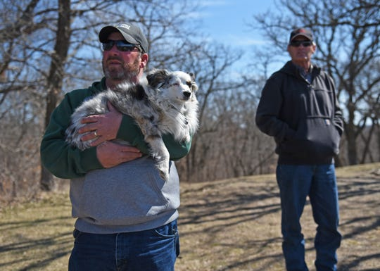 Leo Ettleman and Pat Sheldon look out at miles of flooded farmland from a tall vantage point at Waubonsie State Park in Hamburg on Friday, March 22, 2019. The two farmers are among almost 400 plaintiffs in a lawsuit that claims flood control is no longer the U.S. Corps of Engineers' top priority.
