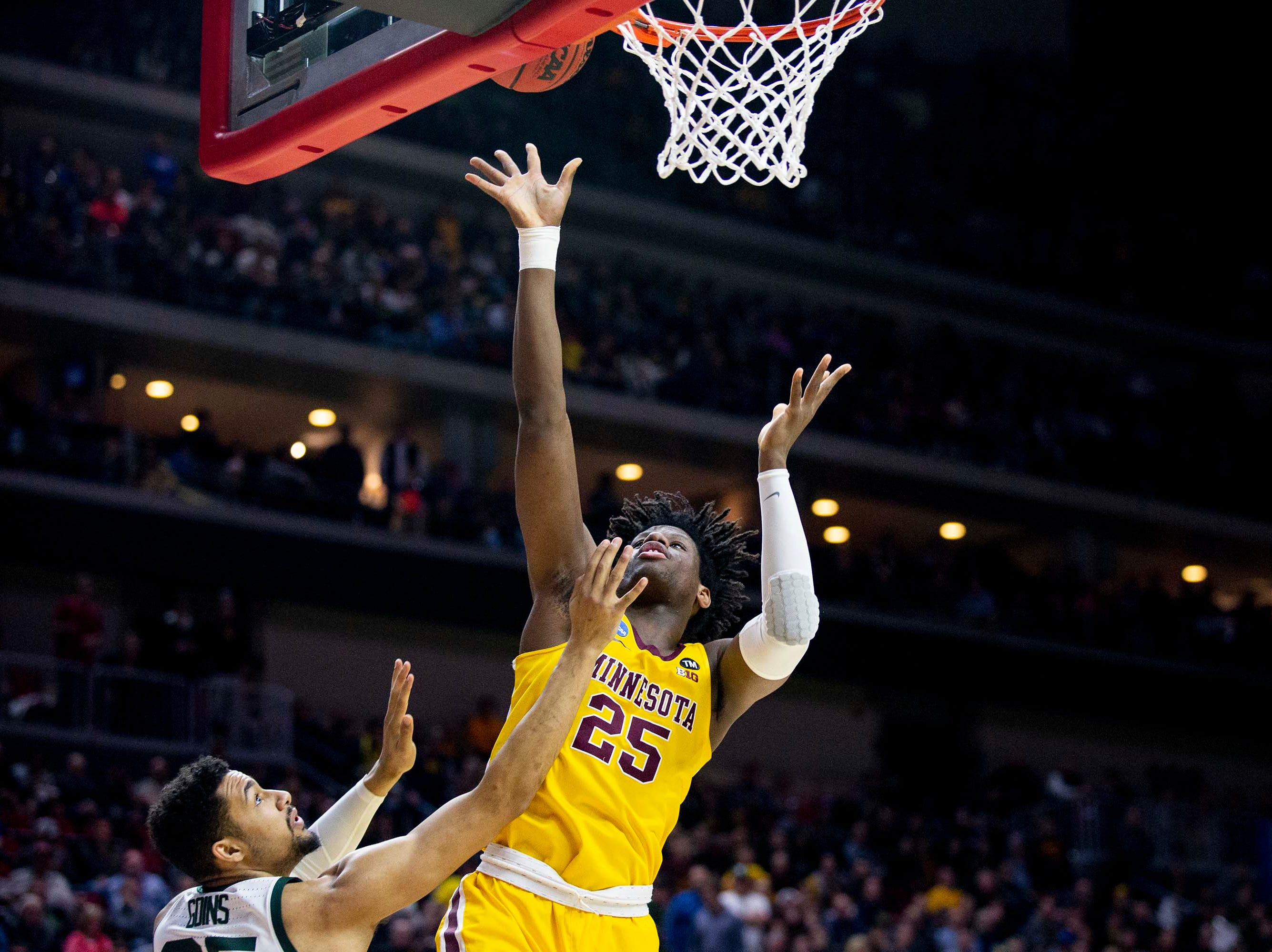 Minnesota's Daniel Oturu shoots the ball during the NCAA Tournament second-round match-up between Minnesota and Michigan State on Saturday, March 23, 2019, in Wells Fargo Arena in Des Moines, Iowa.