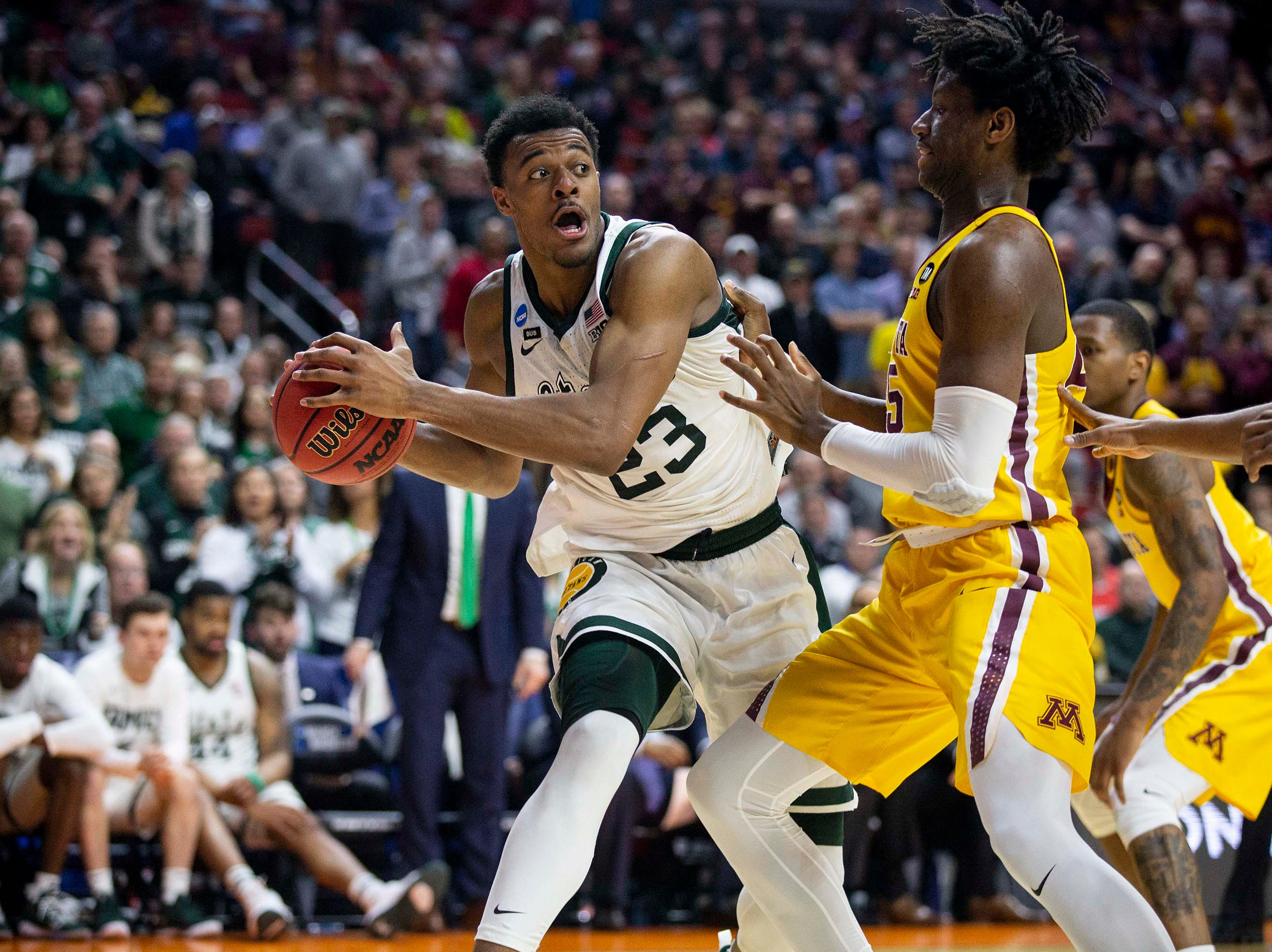 Michigan State's Xavier Tillman looks for an open pass during the NCAA Tournament second-round match-up between Minnesota and Michigan State on Saturday, March 23, 2019, in Wells Fargo Arena in Des Moines, Iowa.