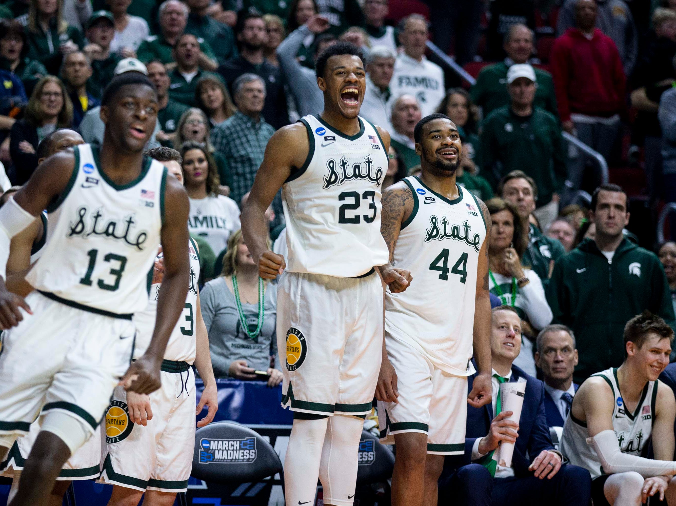 Michigan State's Xavier Tillman celebrates from the bench during the NCAA Tournament second-round match-up between Minnesota and Michigan State on Saturday, March 23, 2019, in Wells Fargo Arena in Des Moines, Iowa.