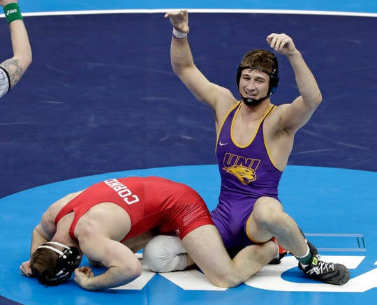 Northern Iowa's Drew Foster, right, celebrates after his win over Cornell's Maxwell Dean in their 184-pound match in the finals of the NCAA wrestling championships Saturday.