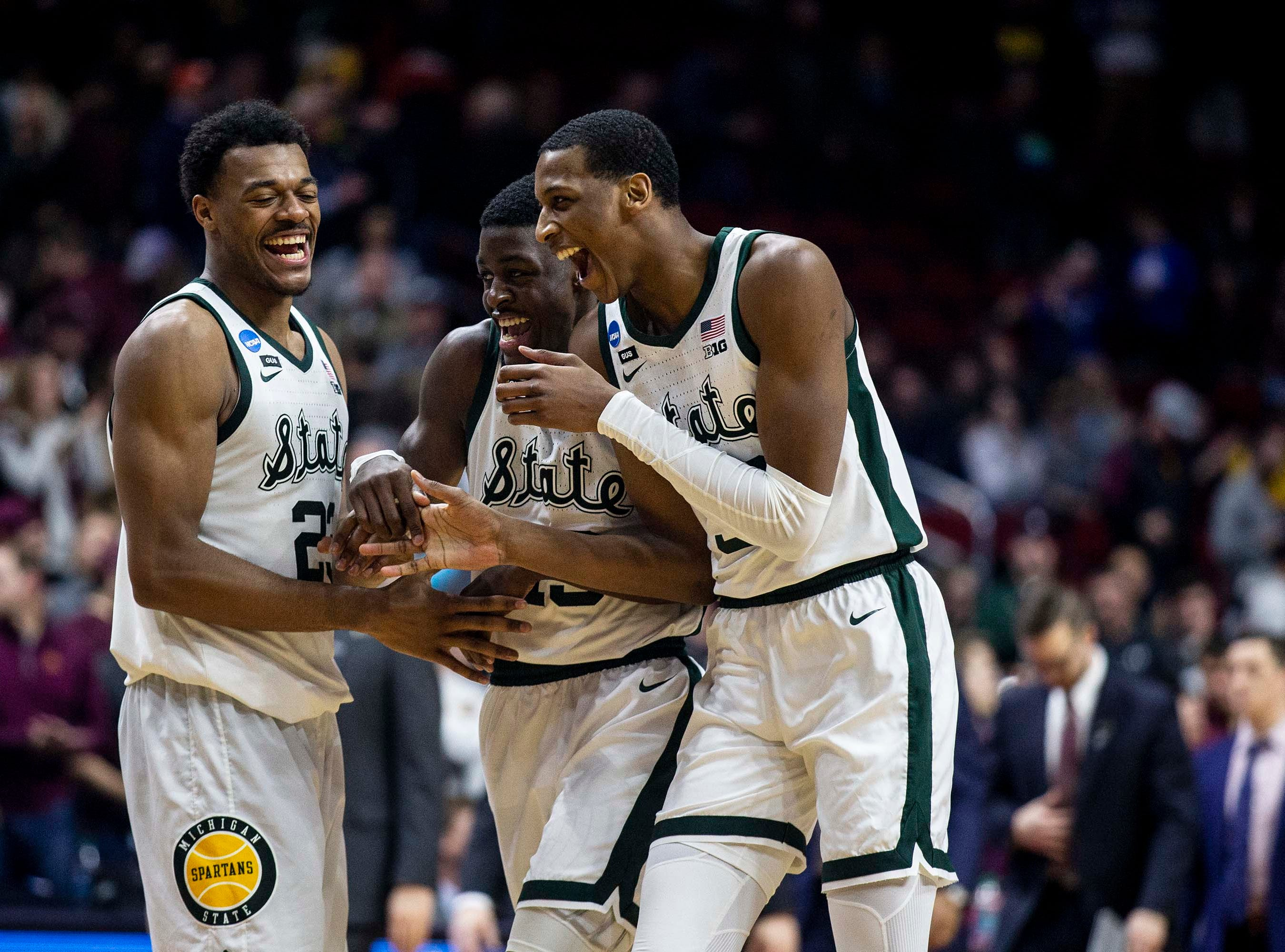 Michigan State players are all smiles after winning the NCAA Tournament second-round match-up between Minnesota and Michigan State on Saturday, March 23, 2019, in Wells Fargo Arena in Des Moines, Iowa.