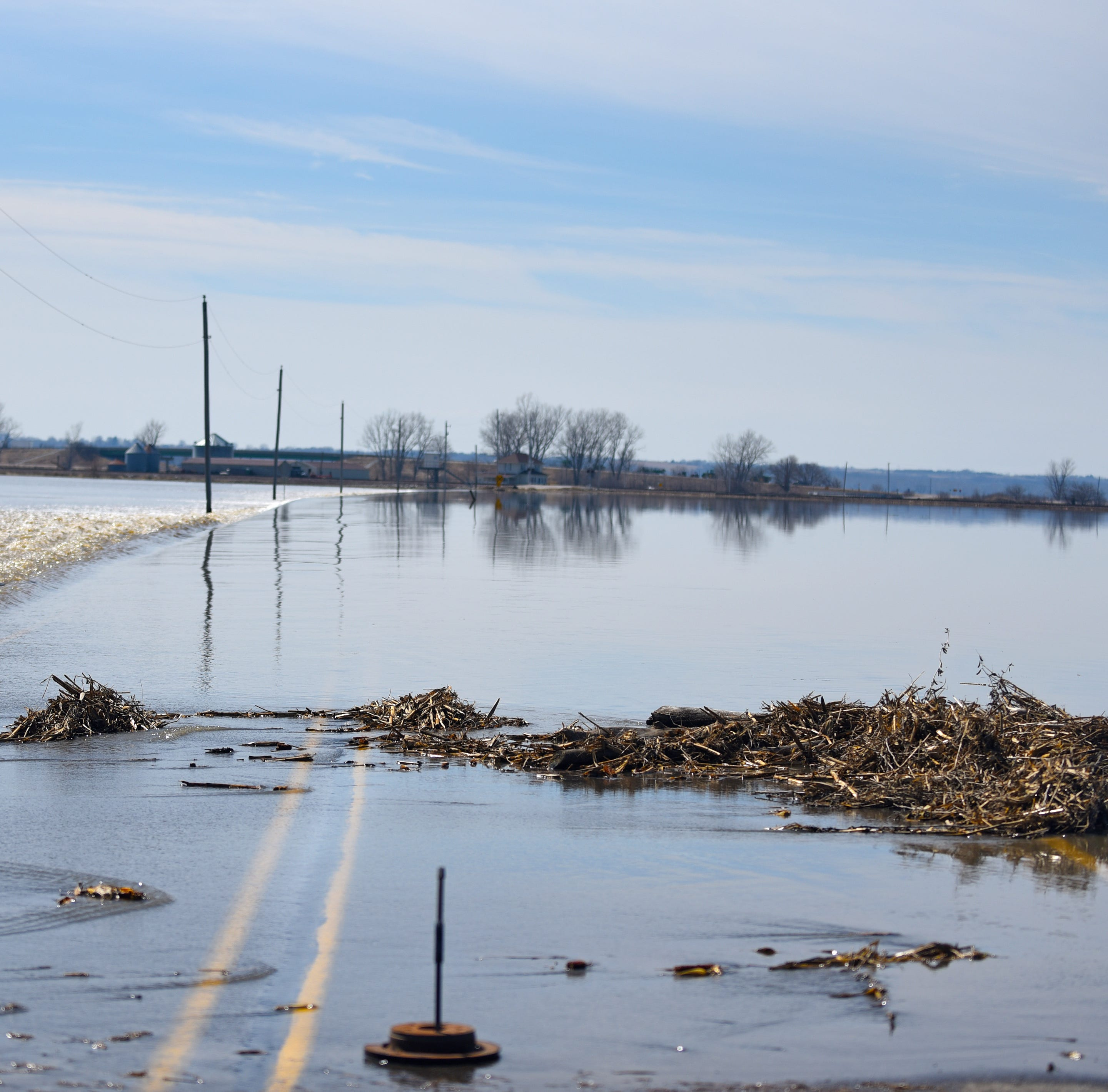 Flooded western Iowa roads could take months to re-open, officials say