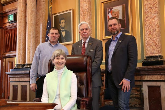 Dan Hanrahan of Cumming, Diane Lair of Winterset and Adam Hill of Indianola from the Madison/Warren County Farm Bureau met with state Rep. Stan Gustafson at the Capitol last week.