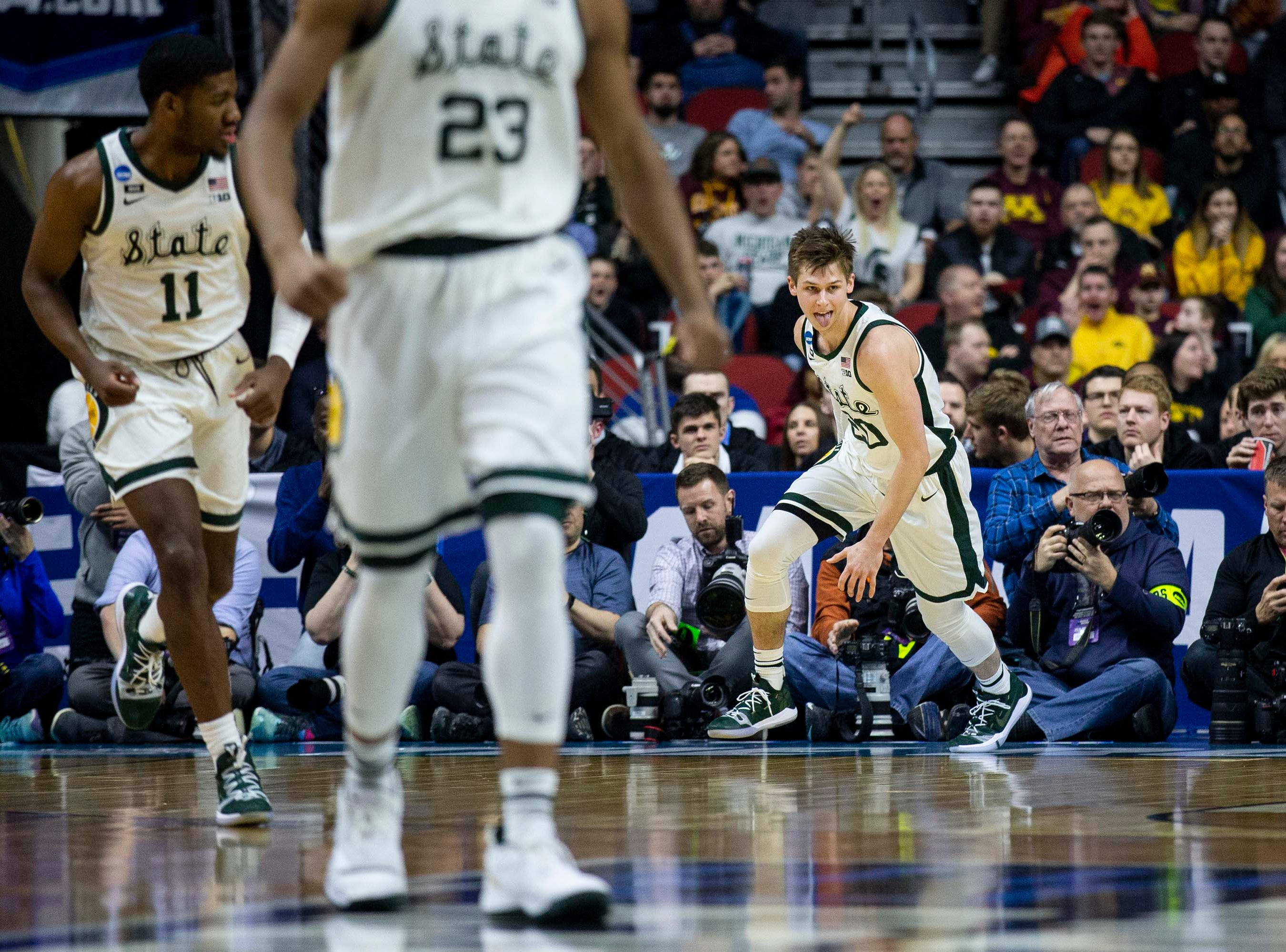 Michigan State's Matt McQuaid celebrates after scoring during the NCAA Tournament second-round match-up between Minnesota and Michigan State on Saturday, March 23, 2019, in Wells Fargo Arena in Des Moines, Iowa.