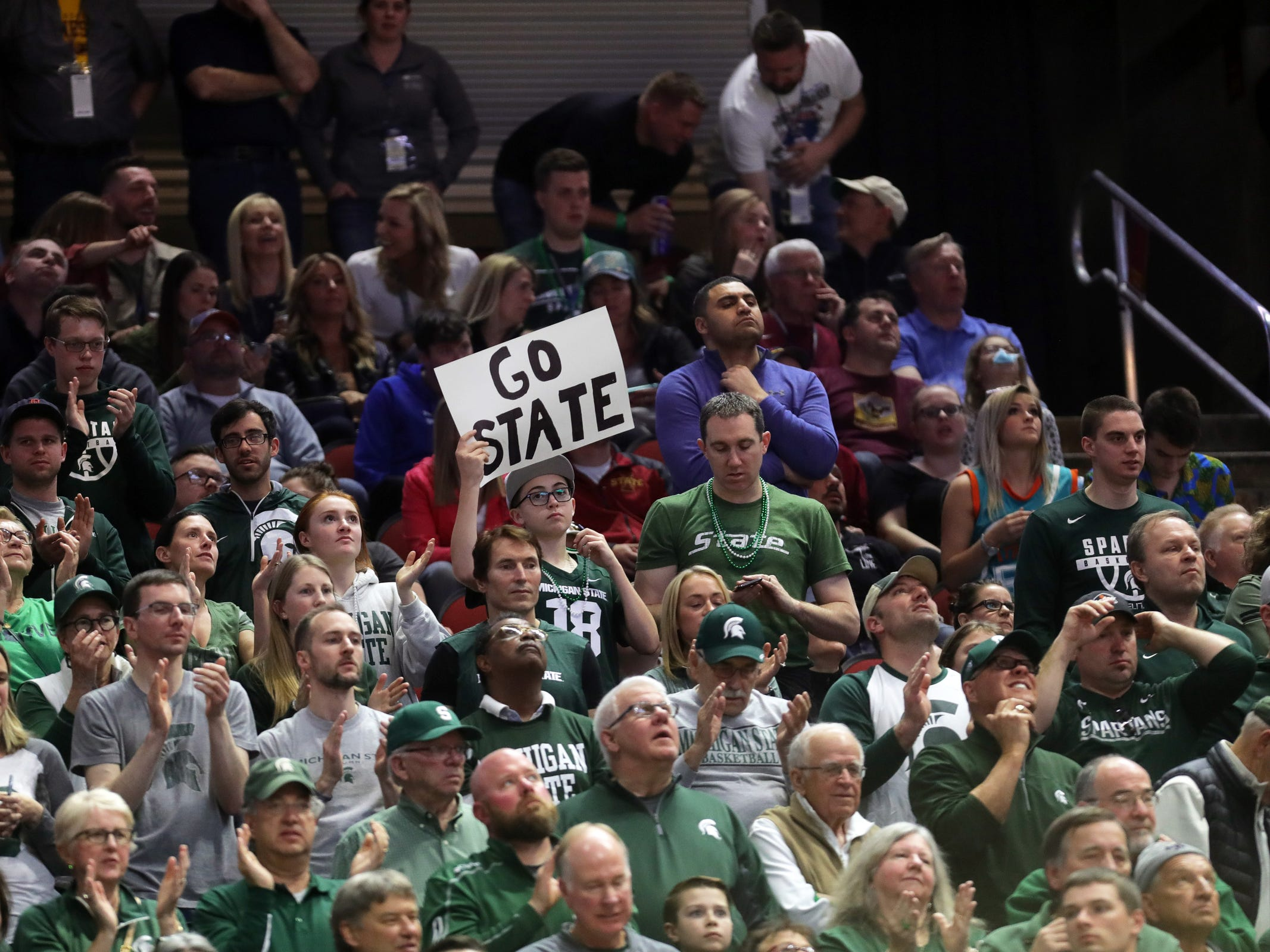 Michigan State fans cheer during the second half of the 70-50 win against Minnesota, Saturday, March 23, 2019 at Wells Fargo Arena in Des Moines, Iowa.