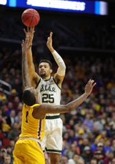 Michigan State's Kenny Goins scores against Minnesota's Dupree McBrayer during the first half of their second round NCAA tournament game Saturday, March 23, 2019 at Wells Fargo Arena in Des Moines, Iowa.