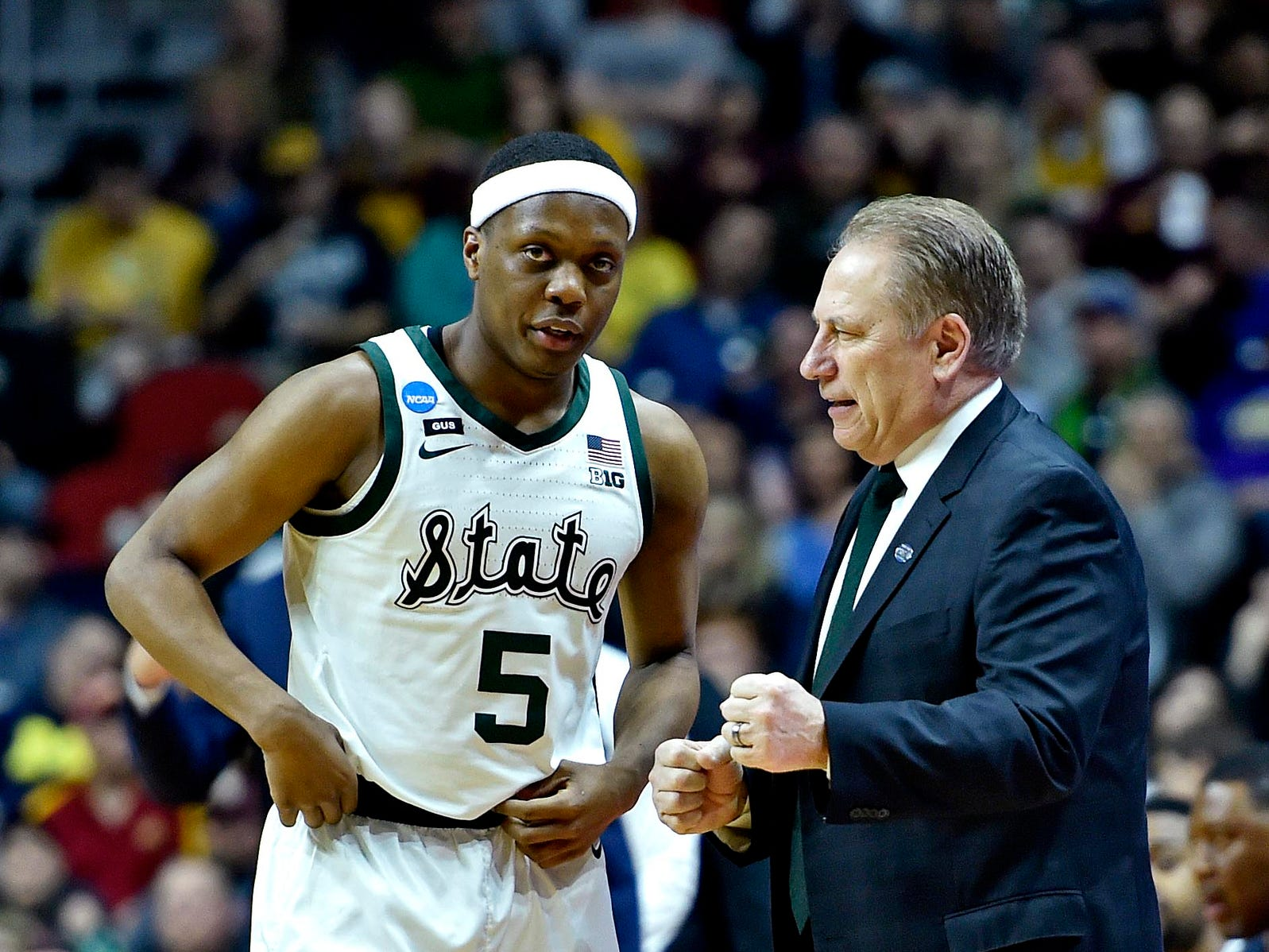 Michigan State coach Tom Izzo talks with guard Cassius Winston in the first half against Minnesota in the second round of the NCAA tournament at Wells Fargo Arena, March 23, 2019.