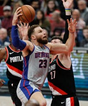 Blake Griffin shoots as Blazers center Jusuf Nurkic defends during the first half in Portland on Saturday.