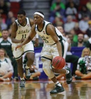 MSU's Cassius Winston surveys the court as Aaron Henry trails during MSU's 70-50 win over Minnesota on Saturday night.
