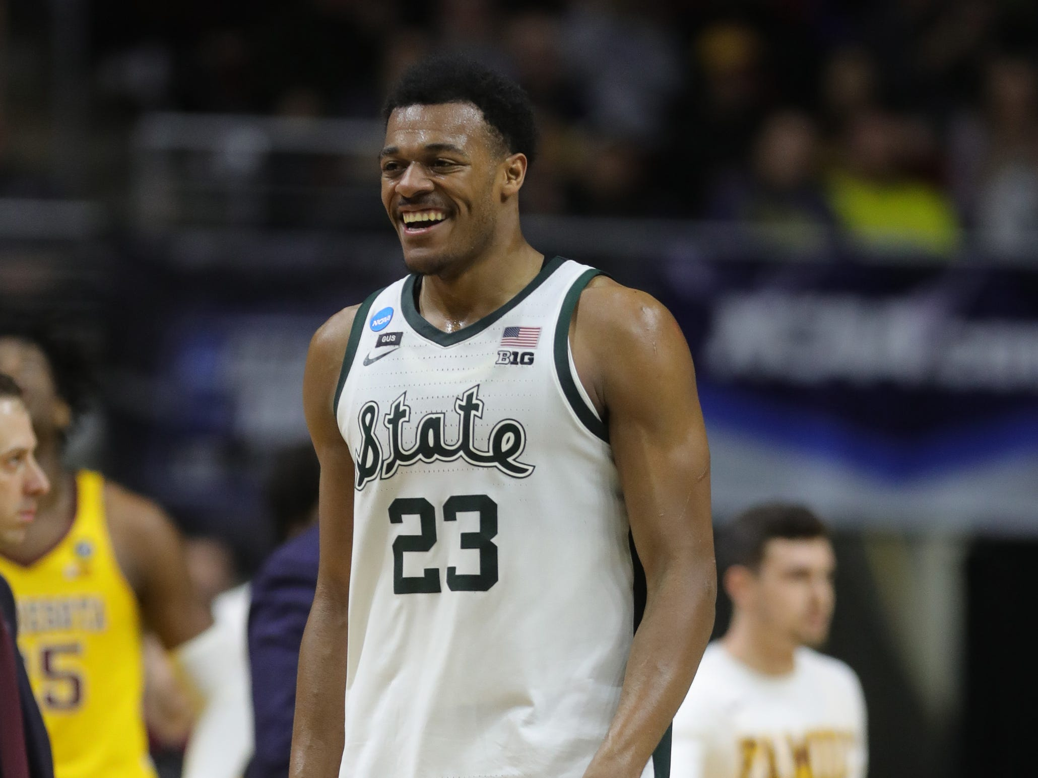 Michigan State's Xavier Tillman smiles as he walks to the bench during the second half against Minnesota in the NCAA tournament Saturday, March 23, 2019 at Wells Fargo Arena in Des Moines, Iowa.