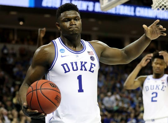 Duke's Zion Williamson reacts after a basket against UCF during the second half in the second round game of the NCAA tournament at Colonial Life Arena on March 24, 2019 in Columbia, SC.
