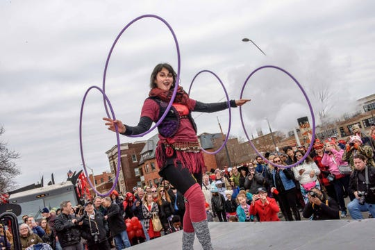Deanna Bedoun performs prior to the 10th annual Marche du Nain Rouge parade through Midtown Detroit on Sunday, March 24, 2019.