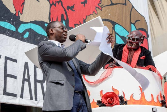 Garland Gilchrist welcomes the the Nain Rouge on the steps of Masonic Temple at the conclusion of the 10th annual Marche du Nain Rouge parade through Midtown Detroit on Sunday, March 24, 2019.