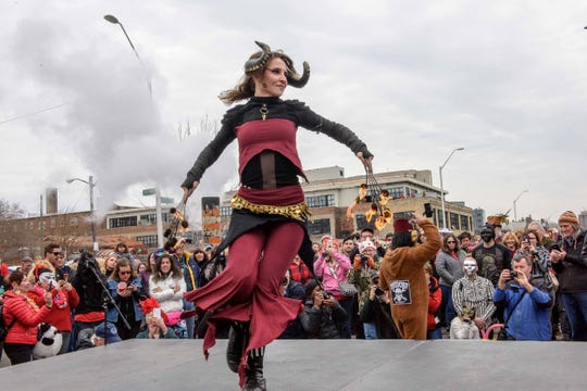Elyse Wade performs prior to the 10th annual Marche du Nain Rouge parade through Midtown Detroit on Sunday, March 24, 2019.