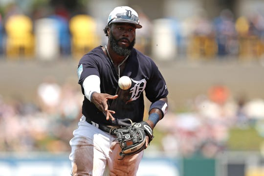 Detroit Tigers second baseman Josh Harrison fields and flips to first base against the Toronto Blue Jays in the second inning at Joker Marchant Stadium, March 24, 2019.
