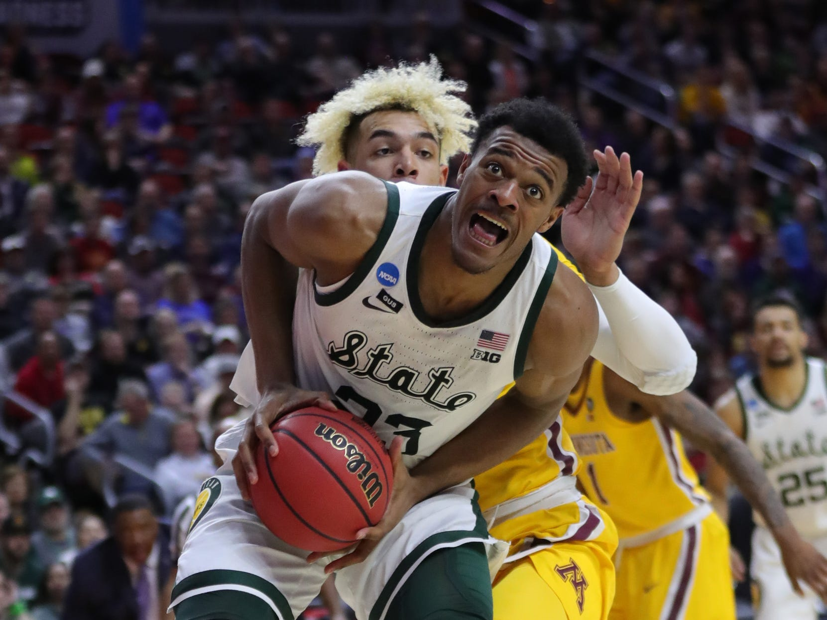Michigan State's Xavier Tillman drives against Minnesota's Jarvis Omersa during the second half of their second round NCAA tournament game Saturday, March 23, 2019 at Wells Fargo Arena in Des Moines, Iowa.