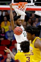 Michigan State's Aaron Henry (11) dunks against Minnesota duri NCAA tournament game in Des Moines, Iowa, Saturday, March 23, 2019.