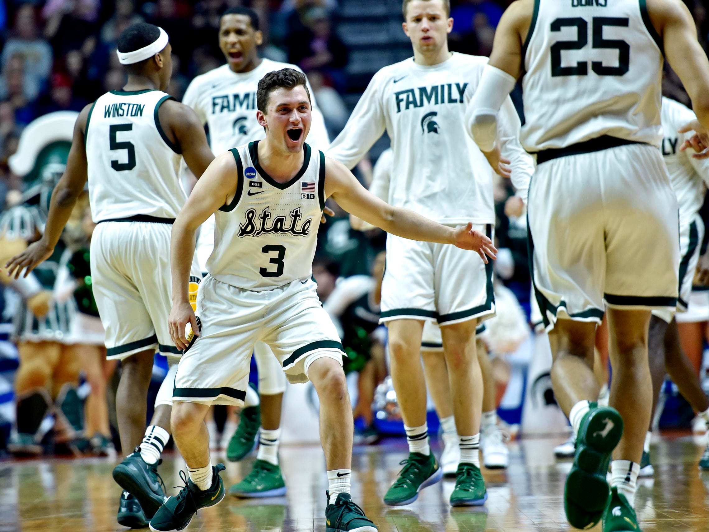 Michigan State guard Foster Loyer (3) celebrates against Minnesota in the first half in the second round of the NCAA tournament at Wells Fargo Arena, March 23, 2019.