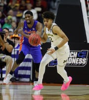 Michigan's Jordan Poole steals the ball against Florida's Kevarrius Hayes during the first half of their second round NCAA tournament game Saturday, March 23, 2019 at Wells Fargo Arena in Des Moines, Iowa.