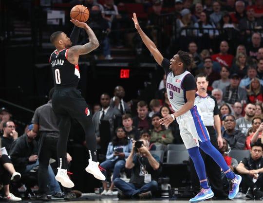 Blazers guard Damian Lillard shoots over the Pistons' Langston Galloway on Saturday.