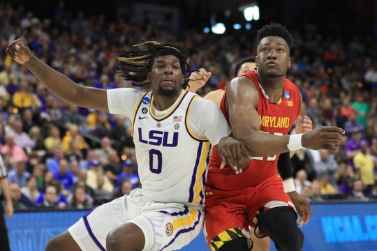 LSU's Naz Reid boxes out Maryland's Jalen Smith during the second round of the NCAA tournament March 23, 2019 in Jacksonville, Fla.