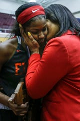 Detroit Edison guard Rickea Jackson (5) gets a kiss and hug from her mother Caryn Jackson after the Pioneers' defeated Freeland to win the MHSAA girls Division 2 final at Van Noord Arena in Grand Rapids, Saturday, March 23, 2019.