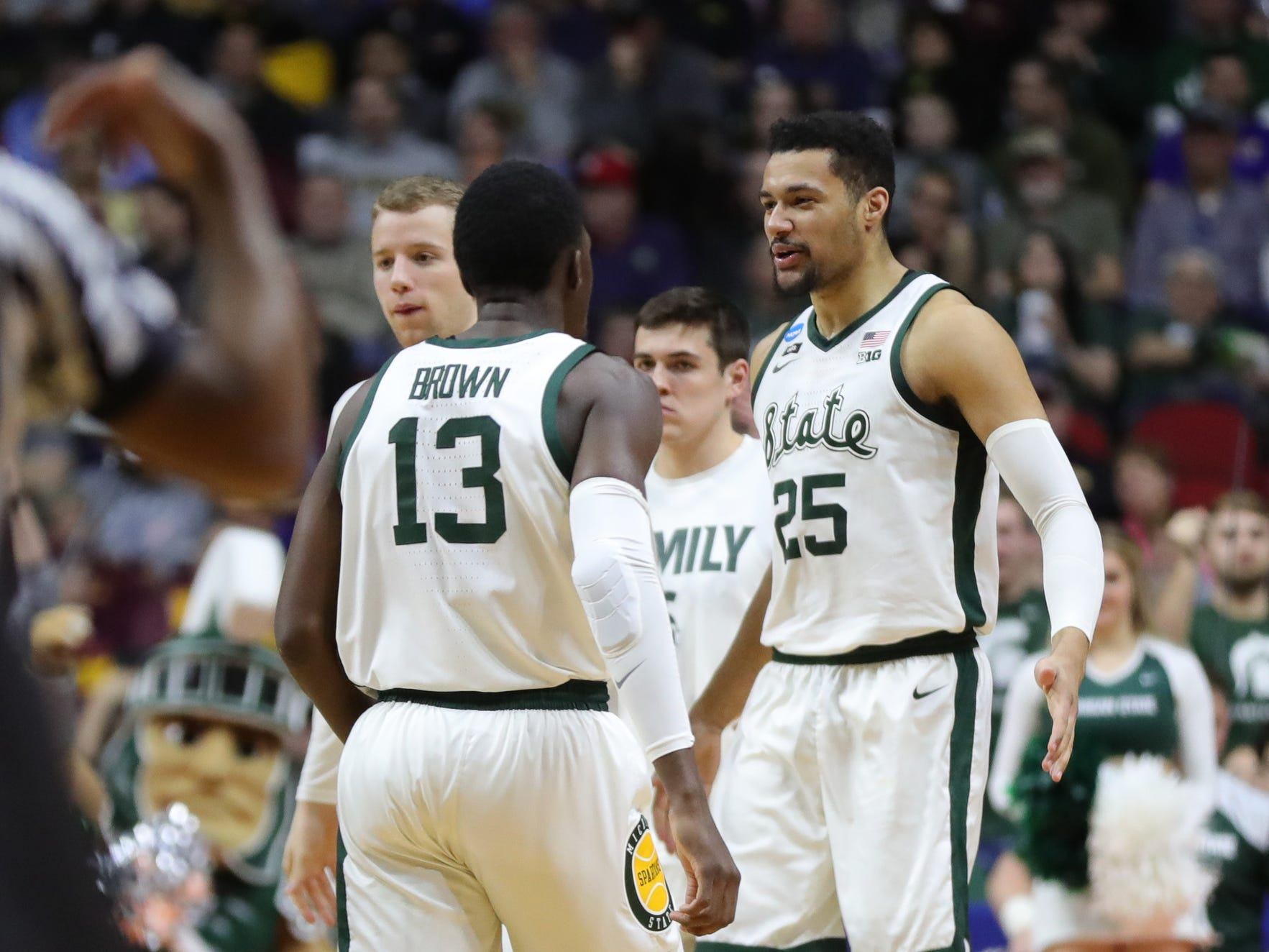Michigan State's Kenny Goins and Gabe Brown celebrate against Minnesota in the first half of their second round NCAA tournament game Saturday, March 23, 2019 at Wells Fargo Arena in Des Moines, Iowa.