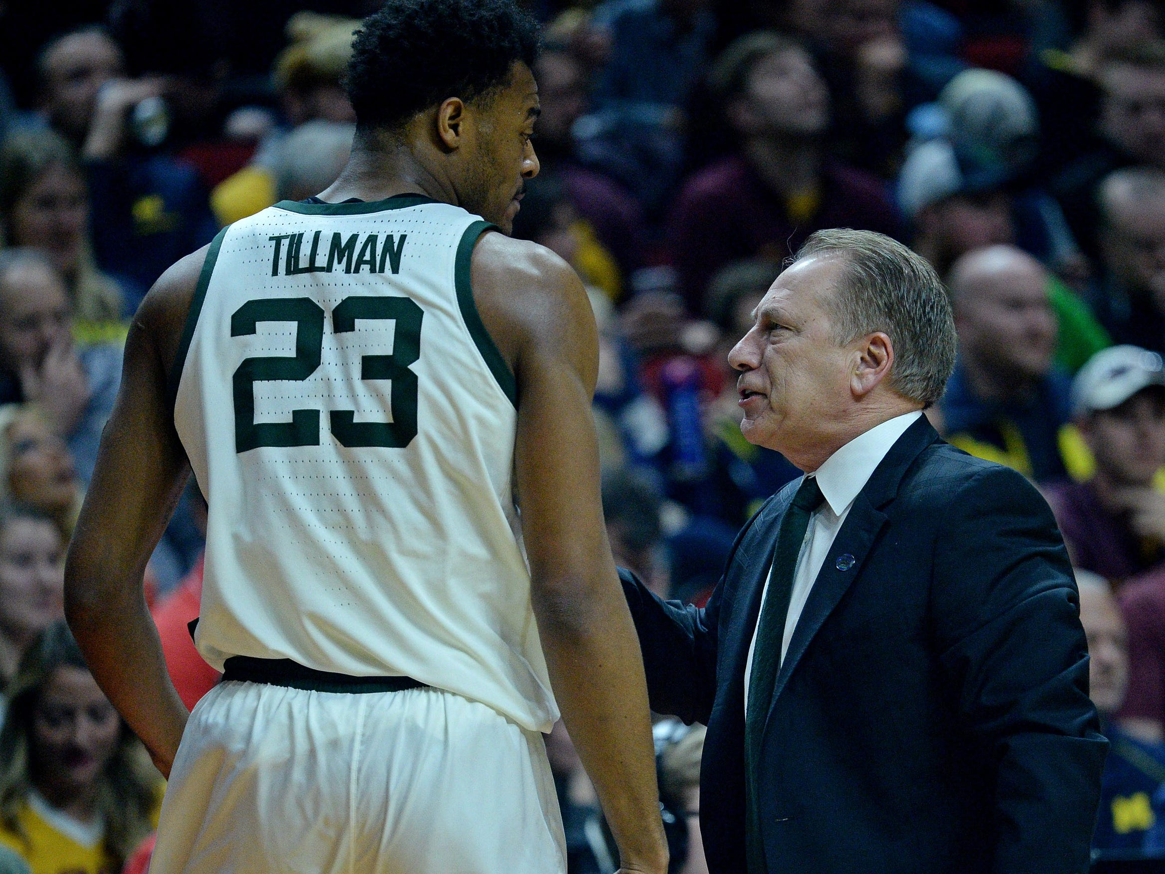 Michigan State coach Tom Izzo talks to forward Xavier Tillman during the first half of a second round NCAA tournament game in Des Moines, Iowa, Saturday, March 23, 2019.