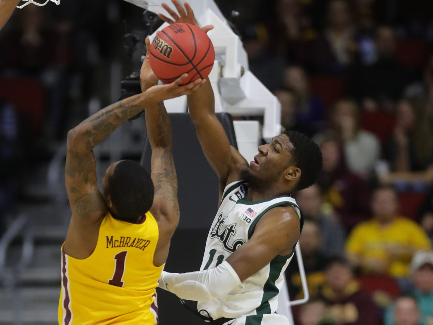 Michigan State's Aaron Henry blocks a shot by Minnesota's Dupree McBrayer in the second half of their second round NCAA tournament game Saturday, March 23, 2019 at Wells Fargo Arena in Des Moines, Iowa.