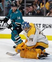 Preds goalie Mattias Ekholm blocks a shot from the Sharks' Gustav Nyquist on March 16, in San Jose.