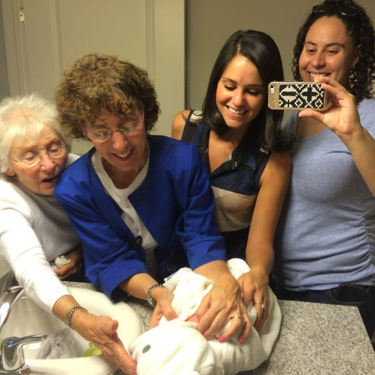 From left: Bella Hirsch (Dr. Pecovitz's Mom) with Oakland University President Ora Hirsch Pescovitz and Ora's daughters (Naomi Pescovitz and Aliza Malouf) admiring Aliza's new son, Rami,  born four years ago.