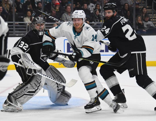 Gustav Nyquist and Kings defenseman Derek Forbort battle for position in the first period at Staples Center on March 21.