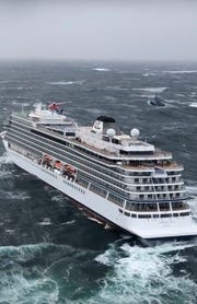Helicopters fly over the cruise ship Viking Sky after it sent out a Mayday signal because of engine failure in windy conditions off the west coast of Norway, Saturday March 23, 2019.