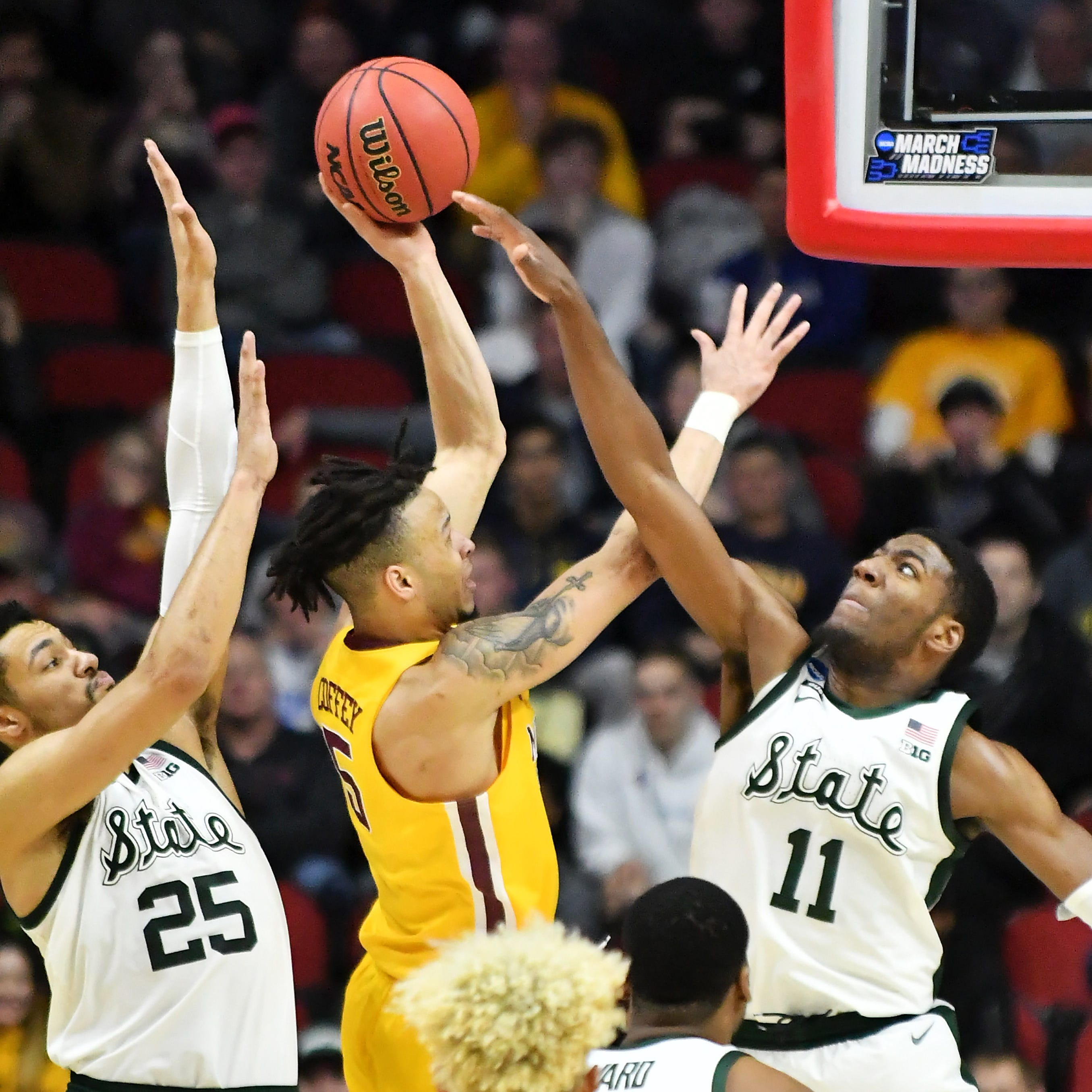 Defensive effort by Henry and McQuaid helps Spartans stifle Gophers