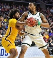 Minnesota forward Jordan Murphy (3) guards Michigan State forward Nick Ward (44) in the first half Saturday.