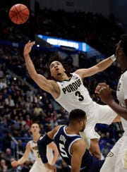 Purdue's Carsen Edwards (3) drives and is fouled by Villanova's Phil Booth (5) during the first half Saturday. Edwards finished with 42 points in Purdue's 87-61 victory.