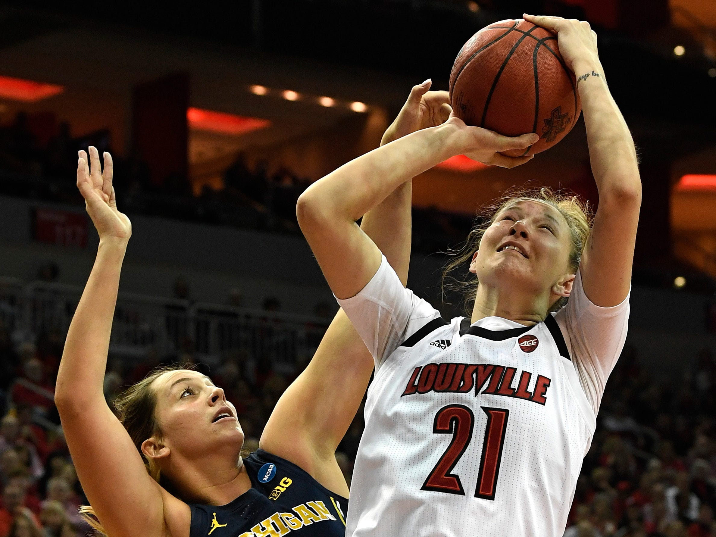 Michigan center Hallie Thome attempts to block the shot of Louisville forward Kylee Shook.