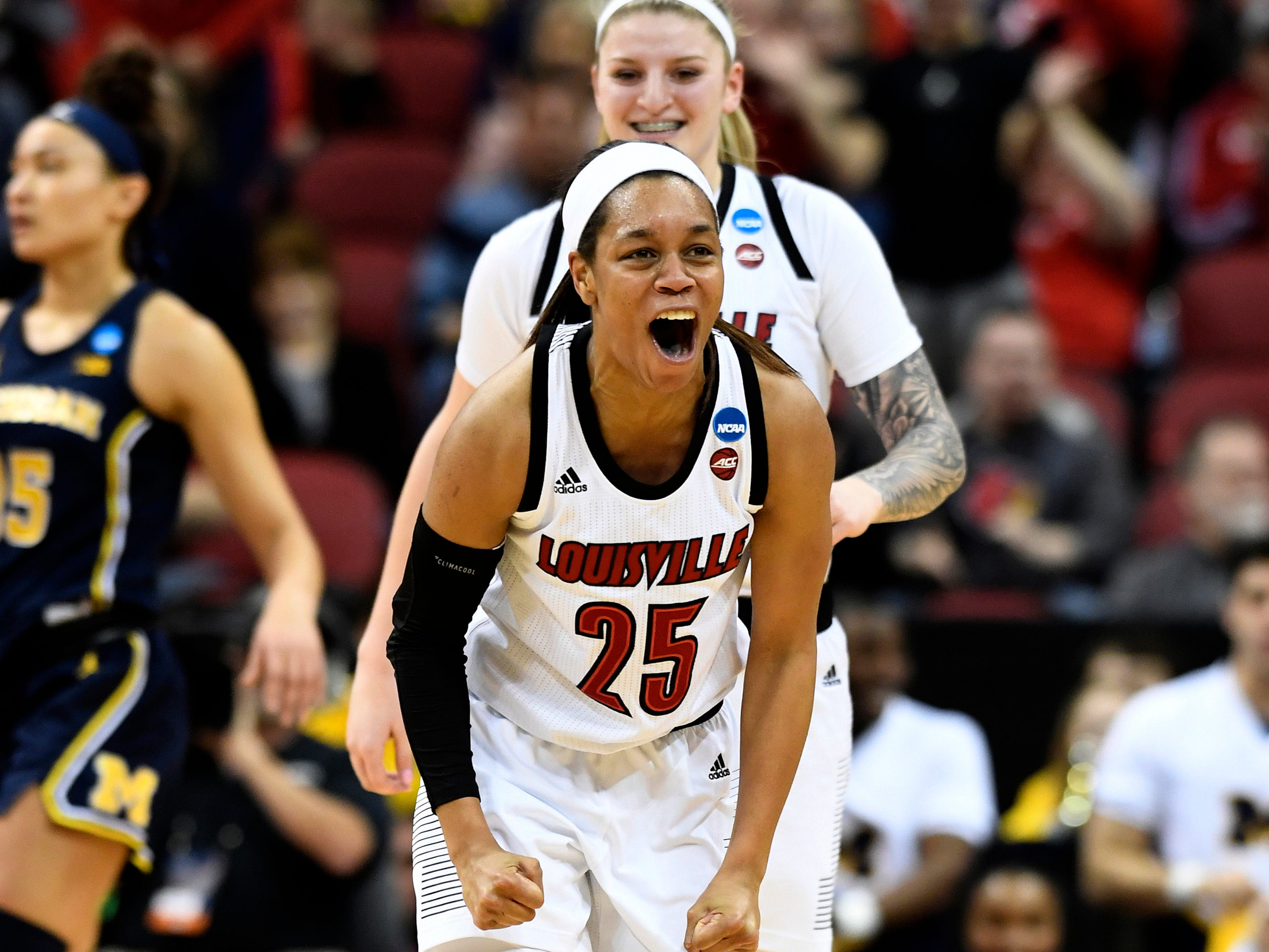 Louisville guard Asia Durr celebrates following a basket.