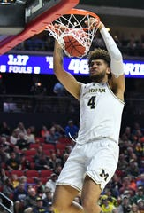 Michigan forward Isaiah Livers (4) dunks in the second half Saturday against Florida in a second-round NCAA Tournament game.